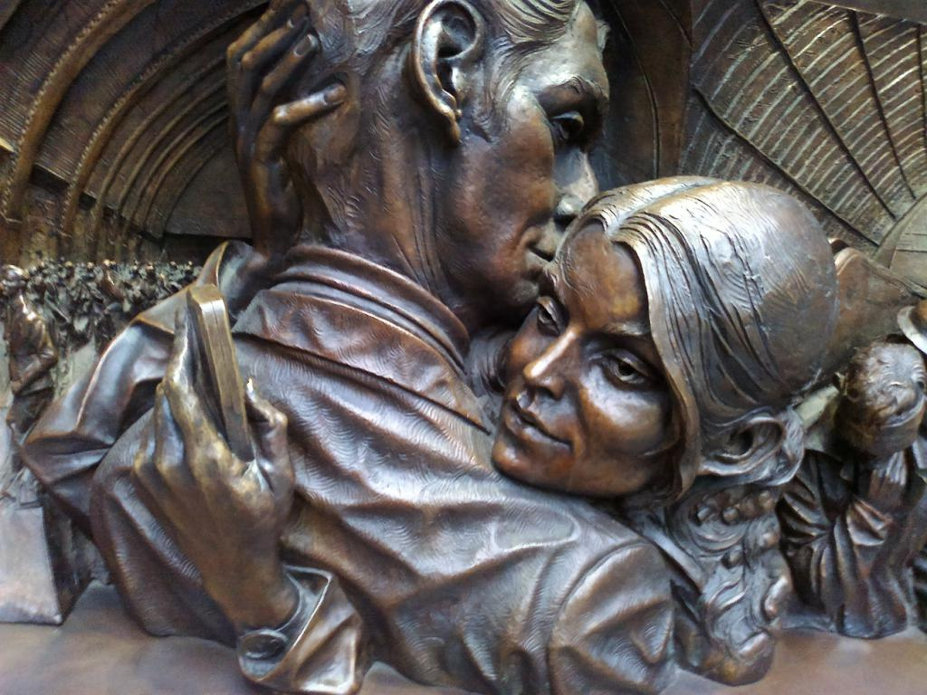 Detail from 'The Kiss' bronze sculpture at St Pancras Station, London