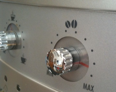 Gnurled rotary dials on a coffee machine, with printed stage indicators